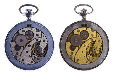 Close-up mechanism of old watch isolated on white background photo