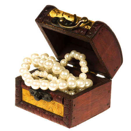 Wooden treasure chest with valuables, isolated over white background photo