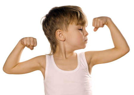 facial muscles: Portrait of little european boy flexing biceps. Beautiful caucasian model. Isolated on white background.