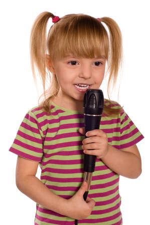 child singing: Child singing with a microphone. Funny little girl isolated on white background. Beautiful caucasian model.