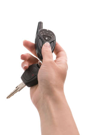 Woman's hand holds out key to the car. Isolated on white background. Stock Photo - 7138132