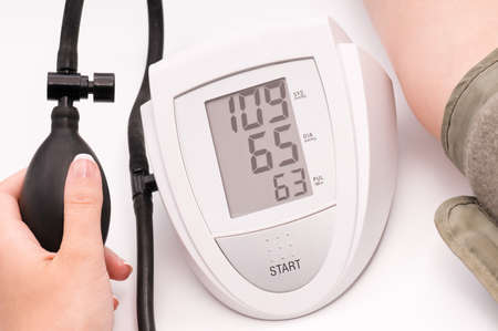Female hands with blood-pressure meter isolated on white background photo