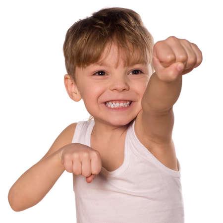 feeble: Funny little boxing  boy isolated on white background. Beautiful caucasian model. Stock Photo