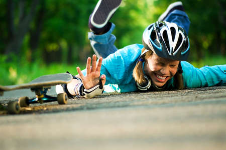 blue helmet: Beautiful teenage girl with skateboard in the green park Stock Photo