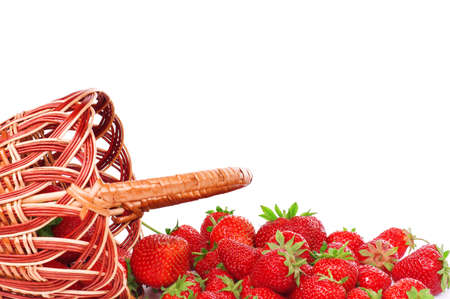 Ripe strawberry in wicker basketbasket isolated on a white background photo
