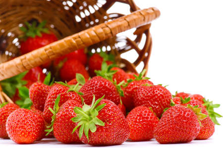 strawberry baskets: Ripe strawberry in wicker basketbasket isolated on a white background Stock Photo