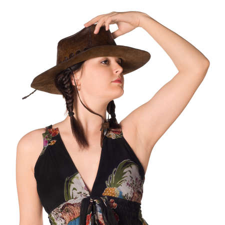 Beautiful caucasian girl in a cowboy hat over white background photo