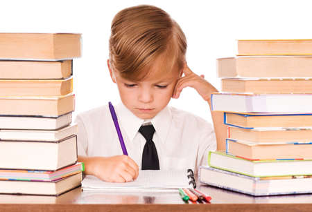 Six years boy writing in the notebook Stock Photo - 7620449