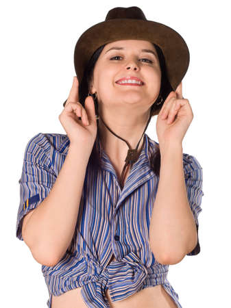 Beautiful young caucasian girl in a cowboy hat over white background photo