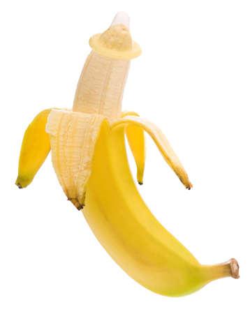Ripe banana with condom isolated on white background photo