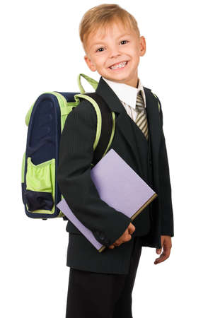 Boy in suit with book isolated on white background. Beautiful caucasian model. photo