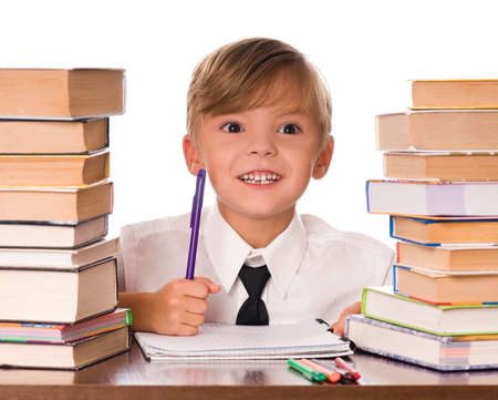 Six years boy writing in the notebook Stock Photo - 7790946