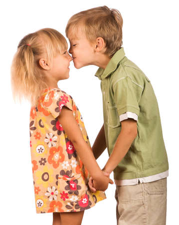 Little boy with girl isolated on white background. Friendly kiss. photo