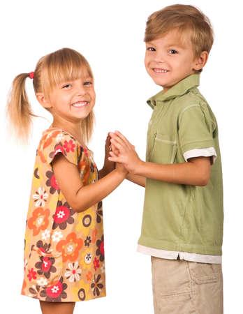 Portrait of emotionally kids. Beautiful caucasian models isolated on white background. photo