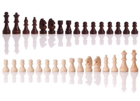 bishop chess piece: A set of black and white chess pieces isolated on a white background
