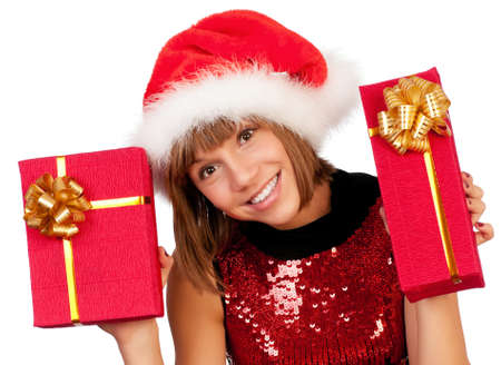 Smiling christmas girl holding gifts wearing Santa hat. Isolated on white background. Stock Photo - 8212040