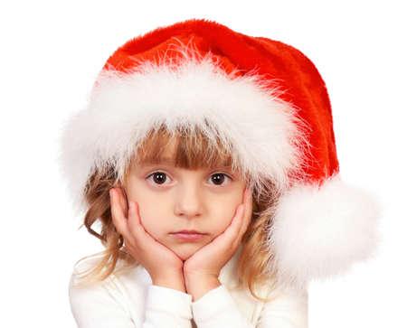 Little christmas girl wearing Santa hat. Isolated on white background. photo