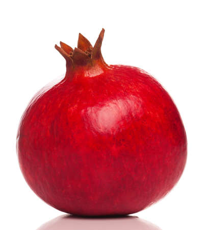 Perfect red pomegranate isolated on white background