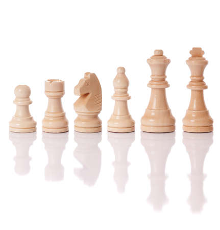 A set of white chess pieces isolated on a white background photo