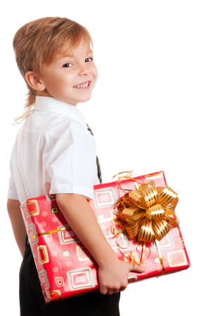 Beautiful boy with gift box isolated on white background photo