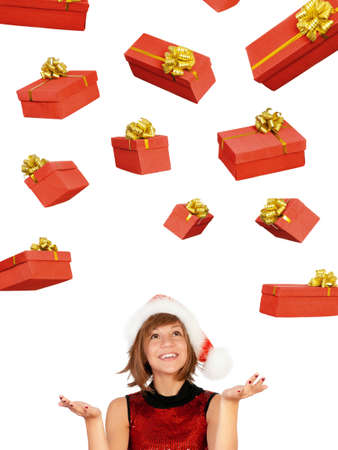 Smiling christmas girl catch gifts wearing Santa hat. Isolated on white background. Stock Photo - 8280428
