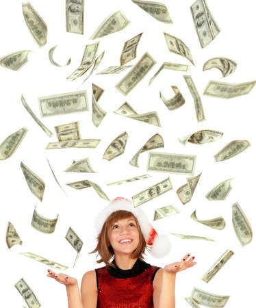 rich people: Smiling christmas girl catching falling dollars banknotes wearing Santa hat. Isolated on white background. Stock Photo
