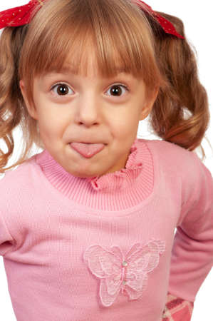 Little beautiful cheerful girl showing tongue photo
