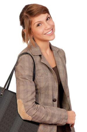Happy beautiful teenage girl holding a shopping bag isolated on white background photo