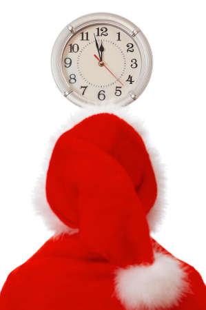 Santa Claus looking on clock. Isolated on white background. Stock Photo - 8280515