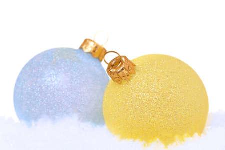 Christmas balls on snow on white background photo