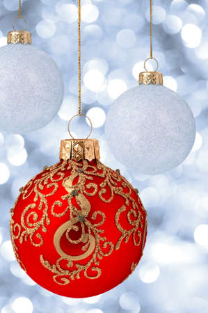 Christmas balls on abstract blue lights as background photo