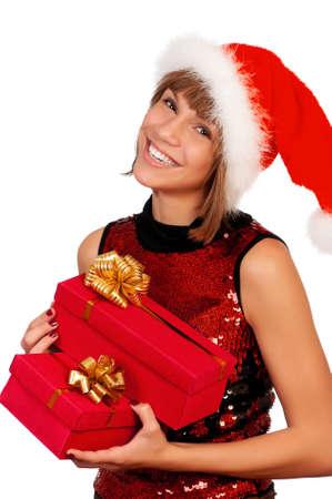 Smiling christmas girl holding gifts wearing Santa hat. Isolated on white background. Stock Photo - 8280619