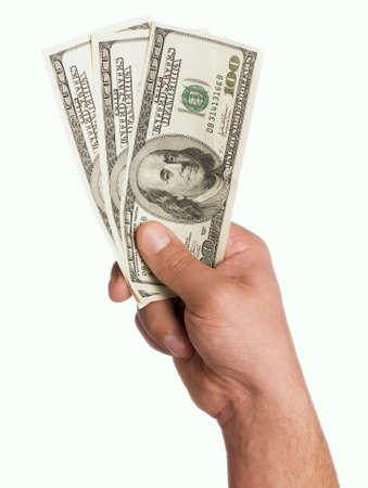 remuneraci�n: Mano tengas dinero d�lares aislados sobre fondo blanco Foto de archivo