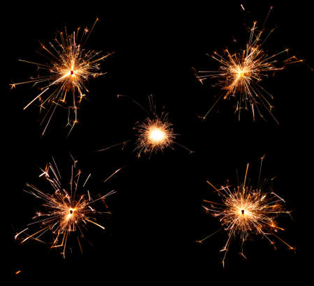 sparklet: Collection of burning christmas sparklers isolated on black background