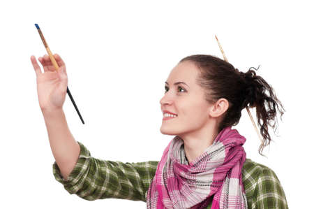 Beautiful girl with paint brush isolated over white background photo