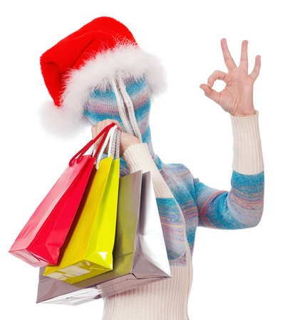 Portrait of a girl in cardigan with a hood with no face – Santa with shopping bags photo