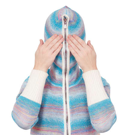 Portrait of a girl in cardigan with a hood with no face. See no evil. photo