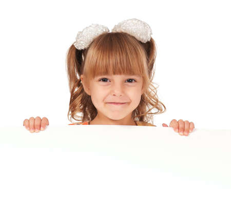 Smiling little girl holding empty white board photo