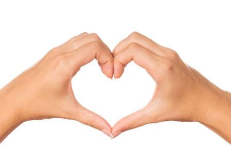 cuore in mano: Donna mano facendo firmare cuore isolato su sfondo bianco Archivio Fotografico