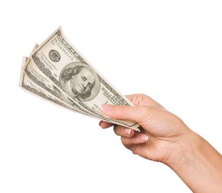 remuneraci�n: Mano dinero d�lares aisladas sobre fondo blanco Foto de archivo