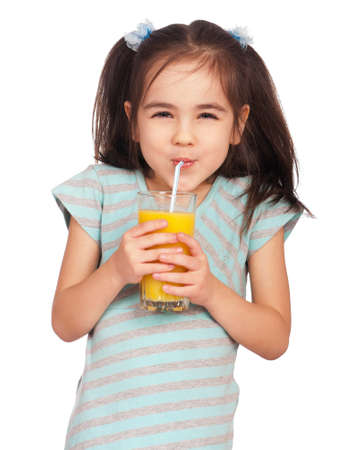 drinking straw: Portrait of happy little girl drinking orange juice Stock Photo