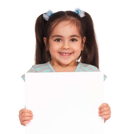 girl holding sign: Smiling little girl holding empty white board Stock Photo