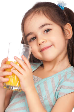 Portrait of happy little girl drinking orange juice photo