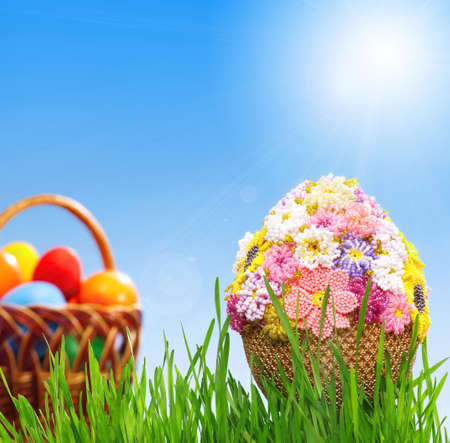 Egg decorated with beads in green grass photo
