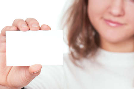 girls holding hands: Young beautiful businesswoman holding empty white board Stock Photo
