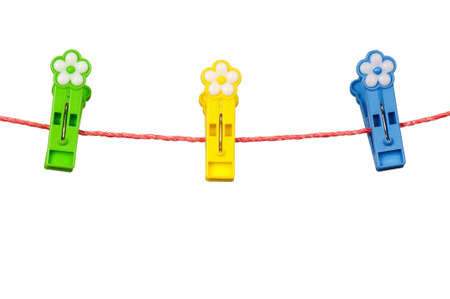 Colorful clothes-pegs on clothesline isolated on white background photo