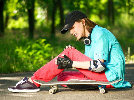 Beautiful teenage girl with skateboard in the green park Stock Photo - 8966372