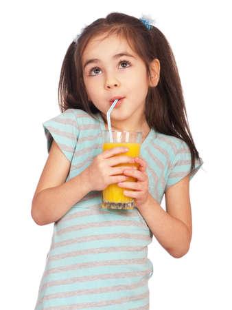 drinking juice: Portrait of happy little girl drinking orange juice Stock Photo