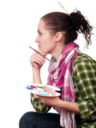 Beautiful girl with brushes. Isolated on white background. photo
