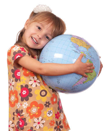 small world: Smiling little girl holding globe. Isolated on white background.